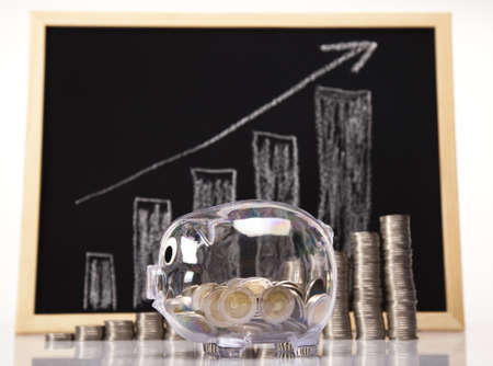 Pig bank and money, Rising Coins  Stock Photo - 17875486