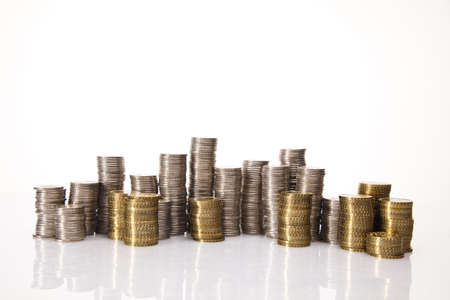 gold bar earn: Stack of coins Stock Photo
