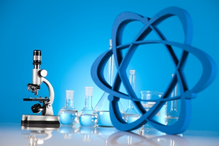 Atom, Molecules model, Laboratory glassware  Stock Photo - 19410364
