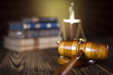 Mallet of judge, legal code and scales Standard-Bild