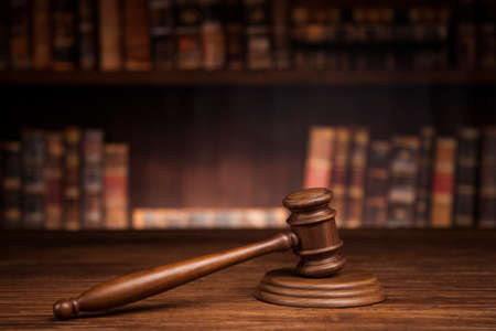 Judge, male judge in a courtroom striking the gavel Stock Photo