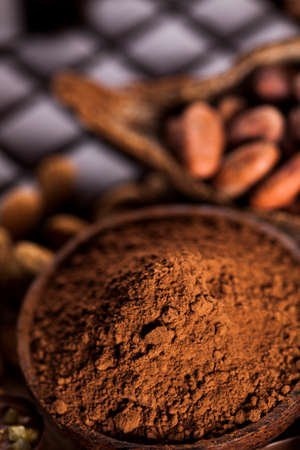Aromatic cocoa, powder and Dark chocolate background