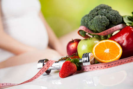 Pregnancy, healthy food and people concept