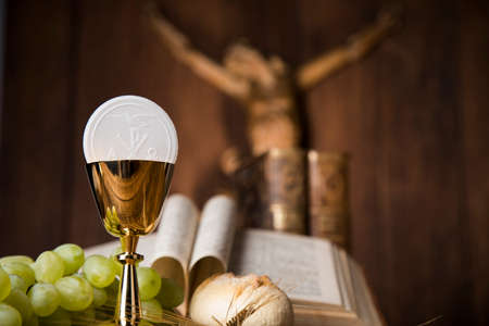 Eucharist symbol of bread and wine, chalice and host, First communion background Stock Photo