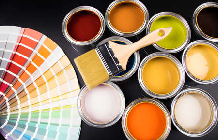 Paint can with a paintbrush Stock Photo