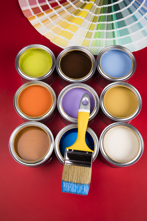 Paintbrush on cans with red background Standard-Bild