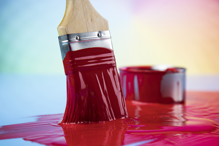 Metal tin cans with color paint and paintbrush Reklamní fotografie