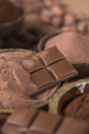 Aromatic cocoa and chocolate on natural paper background