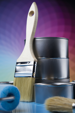 Tin cans with paint, brushes and bright palette of colors