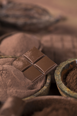 Milk and dark chocolate on a natural paper background Reklamní fotografie