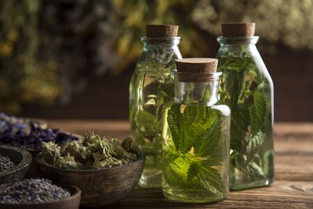 Oil and Natural medicine, wooden table background