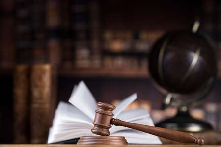 Globe background, Law theme, mallet of judge, wooden gavel