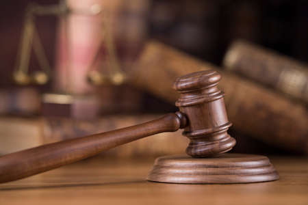 Law theme, mallet of judge, wooden gavel, globe background Standard-Bild