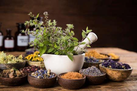 Herbs medicine and vintage wooden background Archivio Fotografico