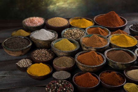 Colorful spices in bowl background Banque d'images