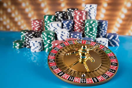 Roulette wheel in motion in a casino background