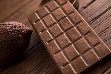 Chocolate bar, candy sweet, cacao beans and powder