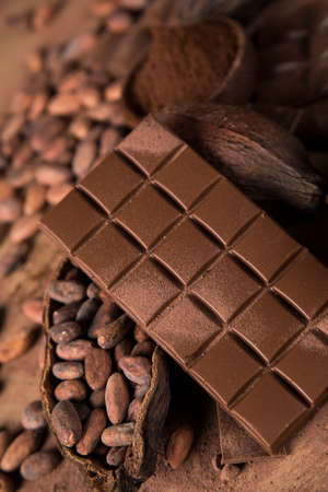 Cocoa pod and chocolate bar and food dessert background