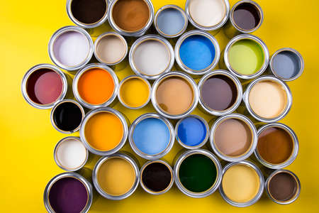 Open buckets with a paint, colors background