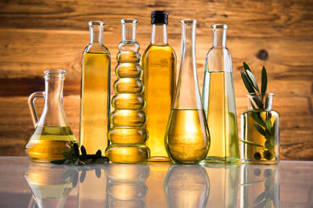 Bottles of olive oil, olive branch and Cooking oils