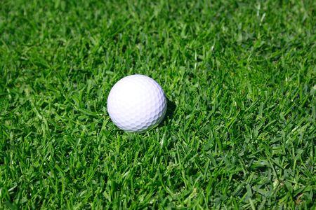 Golf ball on a grass