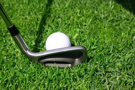 Golf club with golf ball on a tee