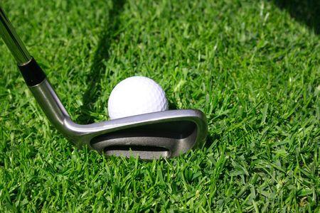 Golf club with golf ball on a tee photo