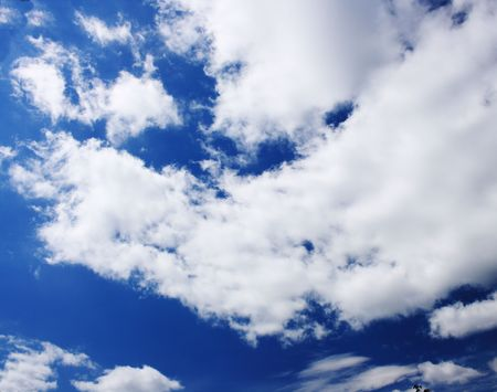 A dramatic blue sky with white clouds Stock Photo