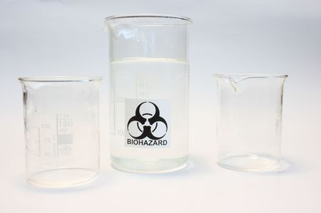 Beakers on white background one with biohazard sign photo
