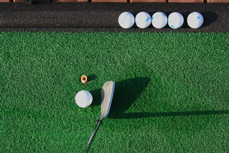 Picture of diving range matt, with golf balls and club Stock Photo