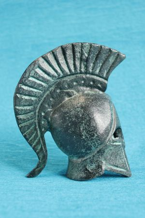 ancient greek helmet isolated on blue background