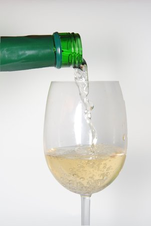 White wine being poured into a wine glass Stock Photo - 1379596