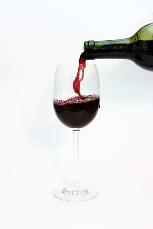 Red wine being poured into a wine glass     Stock Photo