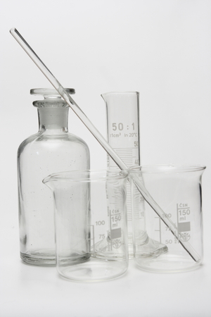 Empty clear graduated cylinder, two beakers, flask and stirring rod