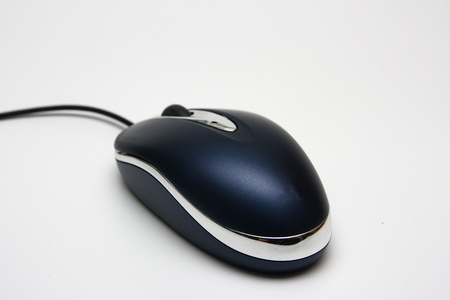 Modern computer mouse isolated on a white background photo