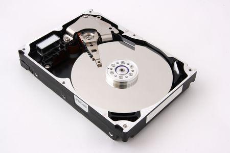 databank: Opened computer harddisk on white background