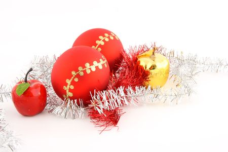 Red christmas ball decorated with gold with christmas apples and chains photo