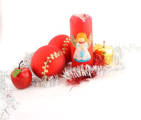 Red christmas ball decorated with gold with christmas apples and red christmas candle photo