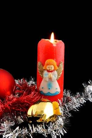Lit red christmas candle with christmas decorations photo