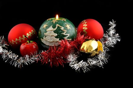 Red christmas ball decorated with gold with christmas apples and lit green christmas candle Stock Photo - 2102226