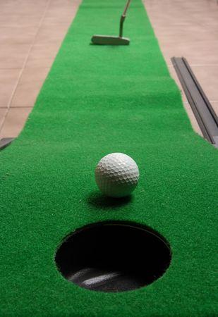 Office golf - golf ball near hole