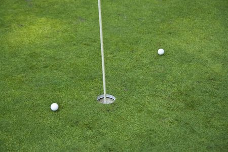 Golf hole on a green with two balls Stock Photo - 2408945