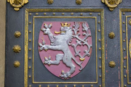 Czech national emblem on gotic church door     photo
