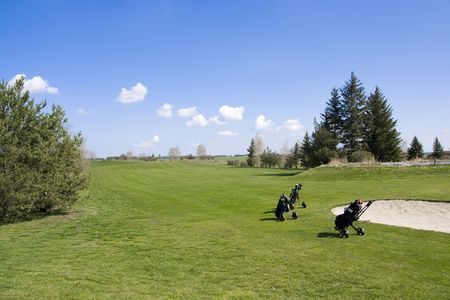 Fairway of golf course with sand traps and troleys Stock Photo - 2898825