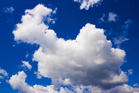pall: A dramatic blue sky with white clouds Stock Photo