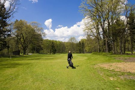 golfers on fairway of a golf course