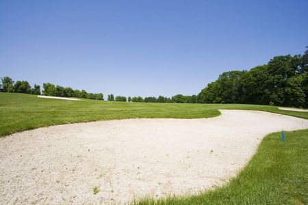 Sand trap on a golf course photo