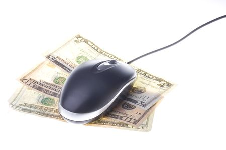 Modern computer mouse on american dollars isolated on a white background Stock Photo - 3304899