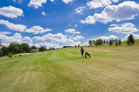 fairway of a beautiful golf course with golfer under dramatic summer sky Stock Photo - 3580329