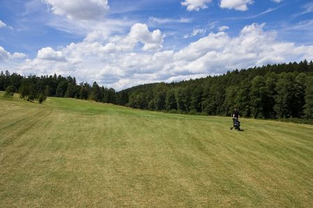 fairway of a beautiful golf course with golfer under dramatic summer sky Stock Photo - 3580361